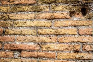 Antique original brick wall - Building Materials of the Colosseum.